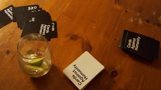 A fierce game of Cards Against Humanity with the Fat Radish Family.